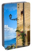 House With Bougainvillea Street Lamp And Distant Sea Portable Battery Charger