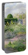 Irises In The Herb Garden Portable Battery Charger