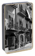 Italian Street In Black And White Portable Battery Charger by Stefano Senise