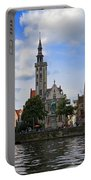 Jan Van Eyck Square With The Poortersloge From The Canal In Bruges Portable Battery Charger