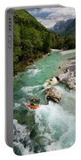 Kayaker Shooting The Cold Emerald Green Alpine Water Of The Uppe Portable Battery Charger