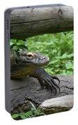Komodo Dragon Climbing Over A Fallen Tree Portable Battery Charger