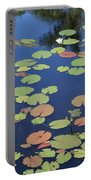 Lily Pads On Blue Pond Portable Battery Charger