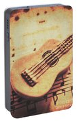 Little Carved Guitar On Sheet Music Portable Battery Charger