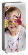 Little Girl Covered In Paint Making Funny Faces. Portable Battery Charger