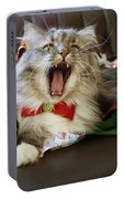 Long Haired Grey And White A Cat Yawns Amid Christmas Wrapping Paper Portable Battery Charger