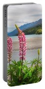 Lupin Flowers In Alpine Scenery At Kinloch, Nz. Portable Battery Charger
