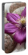 Clematis Flower On Meditation Stones Portable Battery Charger