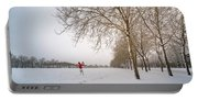 Man In Red Taking Picture Of Snowy Field And Trees Portable Battery Charger