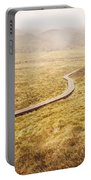 Man On Expedition Along Cradle Mountain Boardwalk Portable Battery Charger