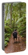 Man Relaxing In Strahan Rainforest Retreat Portable Battery Charger