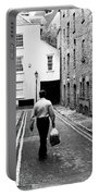 Man Walking With Shopping Bag Down Narrow English Street Portable Battery Charger