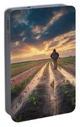Man Watching Sunrise In Tulip Field Portable Battery Charger