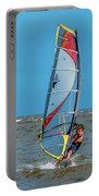 Man Wind Surfing Portable Battery Charger