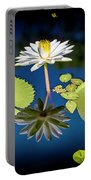 Mid Day Water Lily Reflection Portable Battery Charger