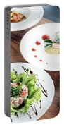 Mixed Modern Gourmet Fusion Food Dishes On Table Portable Battery Charger