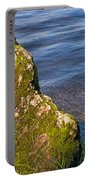 Moss Covered Rock And Ripples On The Water Portable Battery Charger