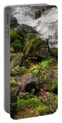 Mossy Rocks And Water Stream Portable Battery Charger