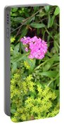 Natural Background With Vegetation And Purple Flowers. Portable Battery Charger