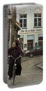 Nun On A Bicycle In Bruges Portable Battery Charger
