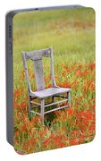 Old Chair In Wildflowers Portable Battery Charger