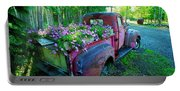 Old Pickup Truck As Flower Bed Portable Battery Charger