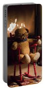 Old Teddy Bear Sitting Front Of The Fireplace In A Cold Night Portable Battery Charger