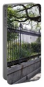 Old Tree And Ornate Fence Portable Battery Charger