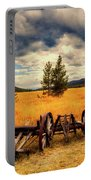 Old Wagons In Meadow Portable Battery Charger