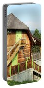 Old Wooden House On Mountain Landscape Portable Battery Charger