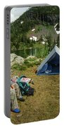 Older Man Resting In Backpacking Camp Portable Battery Charger