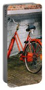 Orange Bicycle In The Street Portable Battery Charger