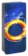 Orange Life Buoy In Blue Water Portable Battery Charger