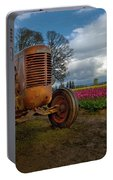 Orange Tractor At Tulip Field Portable Battery Charger