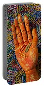 Orange Wooden Hand Holding Paperclips Portable Battery Charger