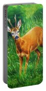 painting of young deer in wild landscape with high grass. Eye contact. Portable Battery Charger