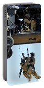 Pararescuemen Are Hoisted Into An Hh-60 Portable Battery Charger