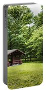 Park Shelter In Lush Forest Landscape Portable Battery Charger