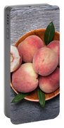 Peaches On A Dark Wooden Background Portable Battery Charger