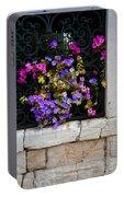 Petunias Through Wrought Iron Window Portable Battery Charger