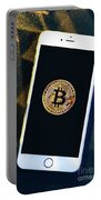 Phone With A Bitcoin Laying On Top Of It. Portable Battery Charger