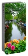 Picturesque View Amsterdam Holland Canal Flowers Portable Battery Charger