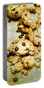 Pile Of Crumbled Chocolate Chip Cookies On Table Portable Battery Charger