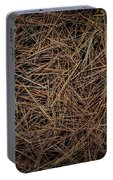Pine Needles On Forest Floor Portable Battery Charger