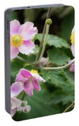 Pink Flowers Over Green Portable Battery Charger