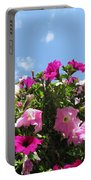 Pink Petunias In The Sky Portable Battery Charger