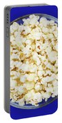 Popcorn In Glass Bowl On Blue Background Portable Battery Charger