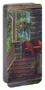 Porch With Red Wicker Chairs Portable Battery Charger