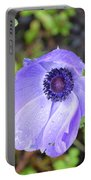 Purple Flowering Anemone Flower In A Lush Green Garden Portable Battery Charger