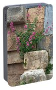 Purple Flowers In Ruins Portable Battery Charger